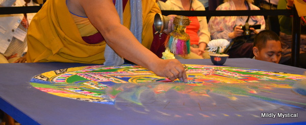 Sweeping Away the Sand Mandala