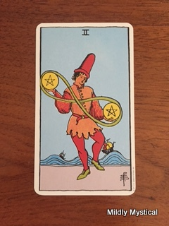 This card has to do with juggling, keeping things in balance, and play